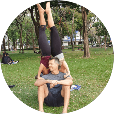 AcroYoga-teacher-grass-and-sand